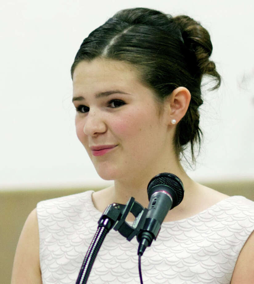 Student essayist Hazel Garrity offers reminiscences about her days at the school during Kent Center School's 85th annual commencement exercises for its eighth grade students, June 18, 2013. Photo: Trish Haldin