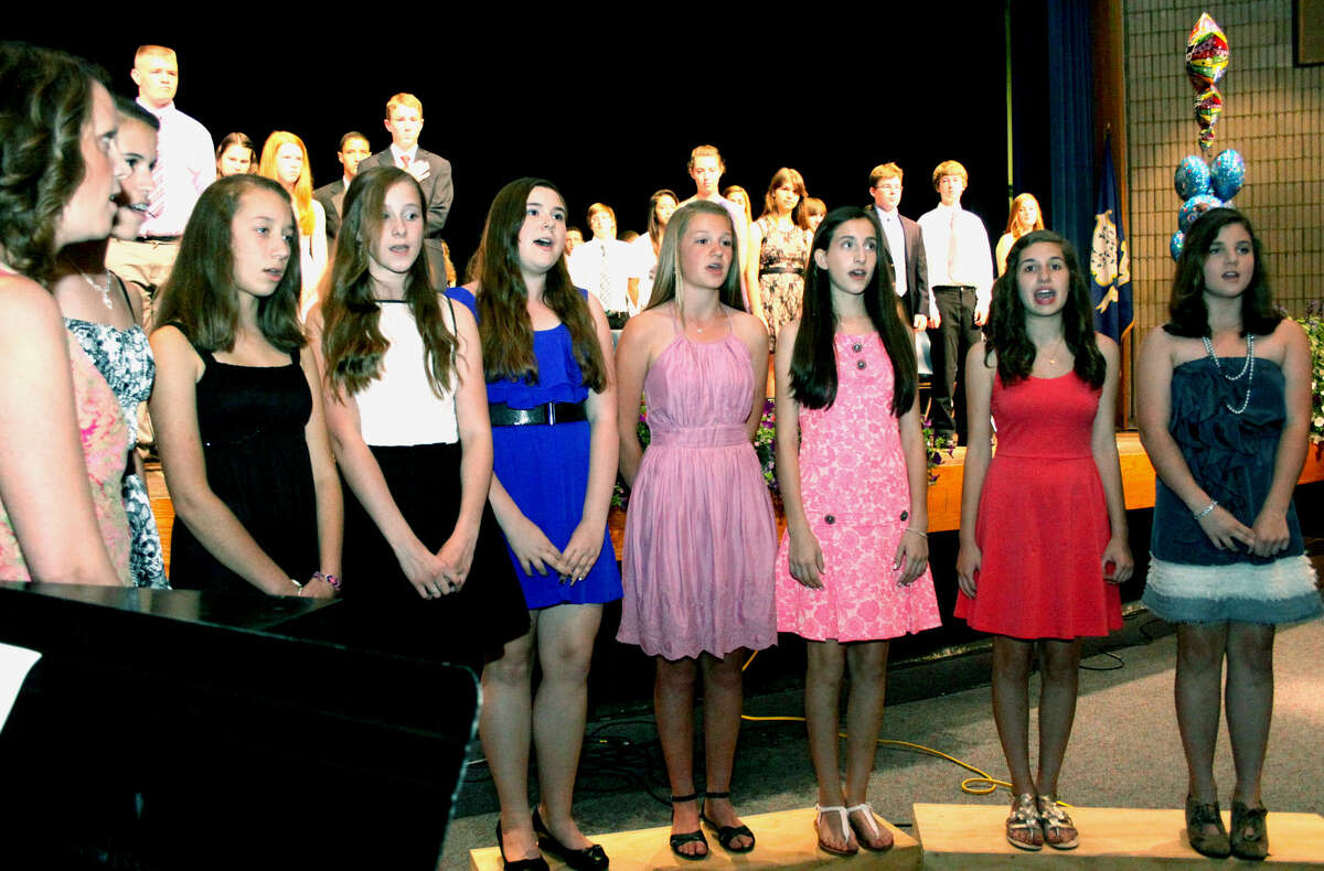 The choir performs the Star Spangled Banner during Shepaug Valley Middle School's promotion ceremony for its eighth graders, June 21, 2013 in Washington