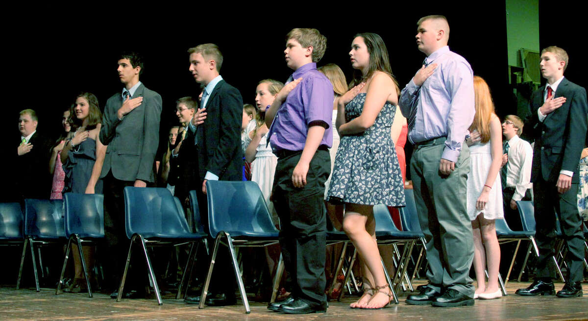 The Class of 2013 offers the Pledge of Allegiance during Shepaug Valley Middle School's promotion ceremony for its eighth graders, June 21, 2013 in Washington