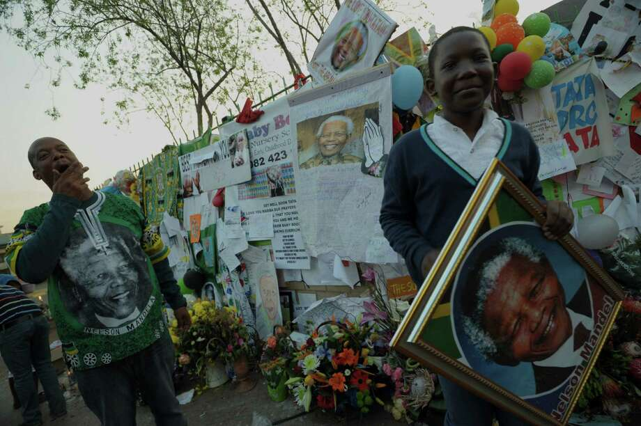Well-wishers gather  outside the MediClinic Heart Hospital where South African President Nelson Mandela is  hospitalized in Pretoria. Mandela is South Africa's George Washington. Photo: Alexander Joe, AFP / Getty Images
