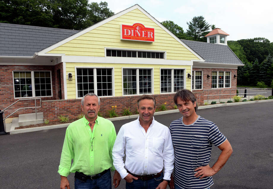 Monroe Diner owner Andy Tsilfides, left, Dimitri Alatakis, center, and Xenofon Tziolis, along Route 25 in Monroe, Conn. on Tuesday July 9, 2013. Photo: Christian Abraham / Connecticut Post