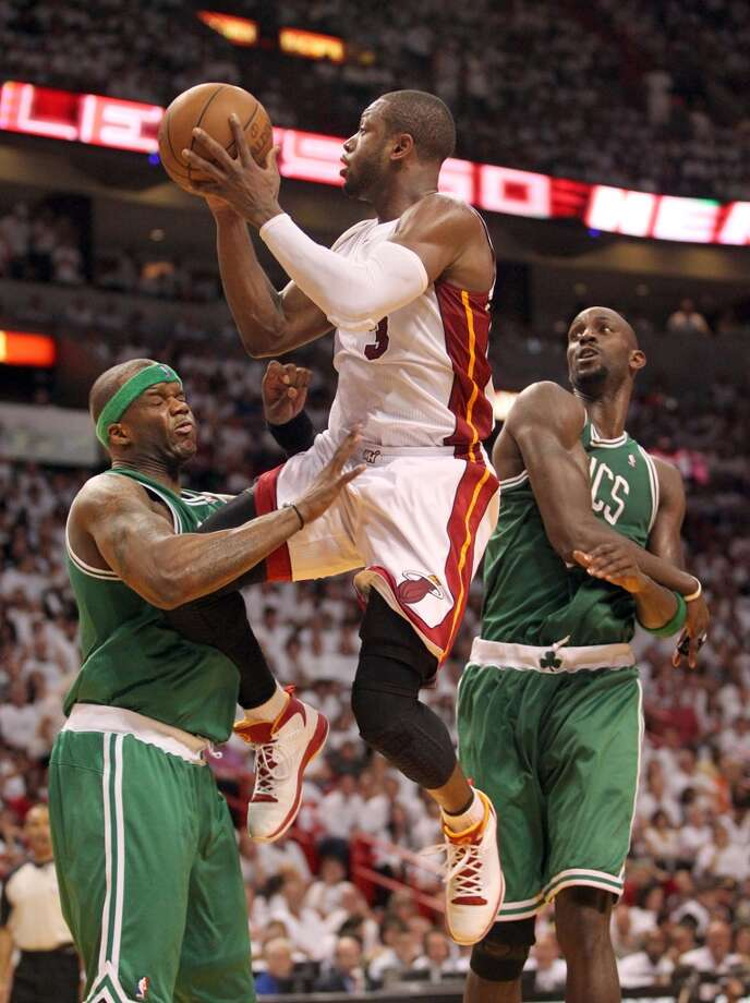 Dwyane Wade of the Miami Heat drives into Jermaine O'Neal of the Boston Celtics in Game 1 of the NBA Eastern Conference Playoffs, Sunday, May 1, 2011.