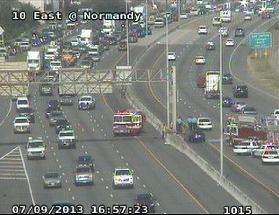 Firefighters respond to a vehicle fire at I-10 and Normandy.
