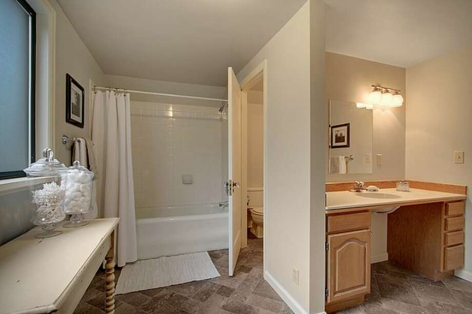 Master bathroom of 7530 Roosevelt Way N.E. The 2,770-square-foot Craftsman, built in 1925, has four bedrooms, two bathrooms, a daylight basement with a rec room and a back deck on a 4,320-square-foot lot. It's listed for $500,000. Photo: Courtesy Steve Laevastu And Roger Turner, Windermere Real Estate