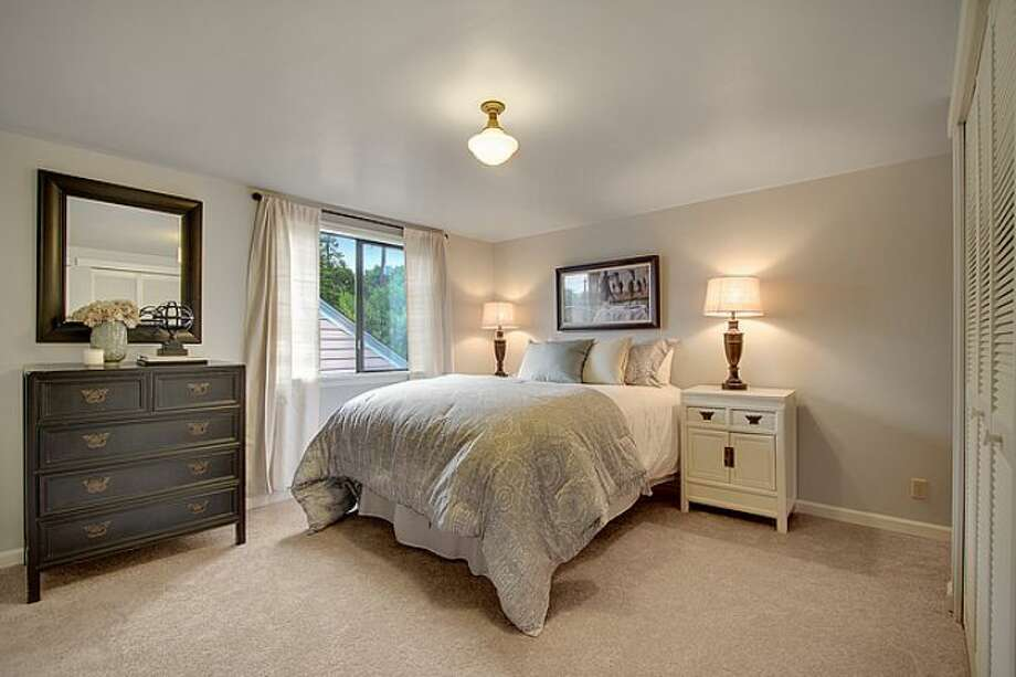 Master bedroom of 7530 Roosevelt Way N.E. The 2,770-square-foot Craftsman, built in 1925, has four bedrooms, two bathrooms, a daylight basement with a rec room and a back deck on a 4,320-square-foot lot. It's listed for $500,000. Photo: Courtesy Steve Laevastu And Roger Turner, Windermere Real Estate