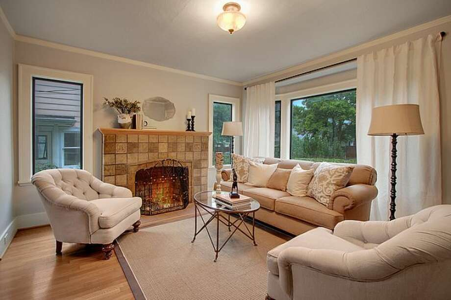 Living room of 7530 Roosevelt Way N.E. The 2,770-square-foot Craftsman, built in 1925, has four bedrooms, two bathrooms, a daylight basement with a rec room and a back deck on a 4,320-square-foot lot. It's listed for $500,000. Photo: Courtesy Steve Laevastu And Roger Turner, Windermere Real Estate