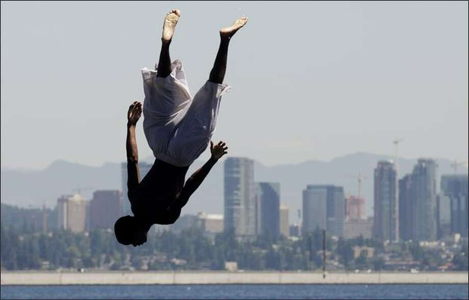 Mount Baker Beach:Like most Lake Washington beaches in Seattle, this one's a gem.   (Pictured is Antonio Jones doing a flip off a diving board). Photo: Dan DeLong / Seattle Post-Intelligencer