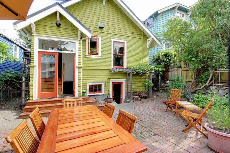Back yard of 1019 N.E. 69th St. The 1,900-square-foot house, built in 1912, has four bedrooms, 1.75 bathrooms, 9-foot ceilings, a cook's range, built-ins, a wine cellar, and front and back patios. It's listed for $489,000, although a sale is pending. Photo: Courtesy Joanie Brennan And Anne Marie Peterson, Windermere Real Estate