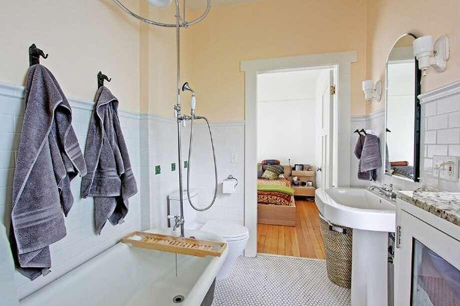 Bathroom of 1019 N.E. 69th St. The 1,900-square-foot house, built in 1912, has four bedrooms, 1.75 bathrooms, 9-foot ceilings, a cook's range, built-ins, a wine cellar, and front and back patios. It's listed for $489,000, although a sale is pending. Photo: Courtesy Joanie Brennan And Anne Marie Peterson, Windermere Real Estate
