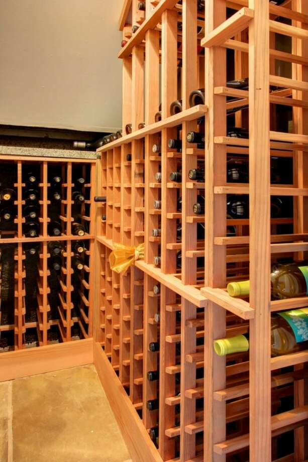 Wine cellar of 1019 N.E. 69th St. The 1,900-square-foot house, built in 1912, has four bedrooms, 1.75 bathrooms, 9-foot ceilings, a cook's range, built-ins, and front and back patios. It's listed for $489,000, although a sale is pending. Photo: Courtesy Joanie Brennan And Anne Marie Peterson, Windermere Real Estate