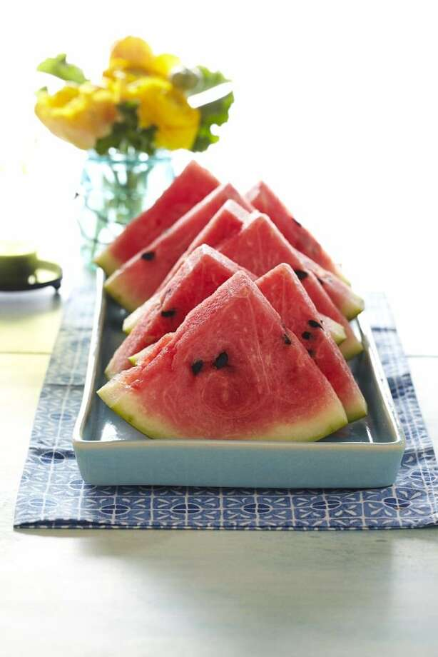 Good Housekeeping recipe for Watermelon Slices with Lime-Honey Syrup. Photo: Kate Mathis