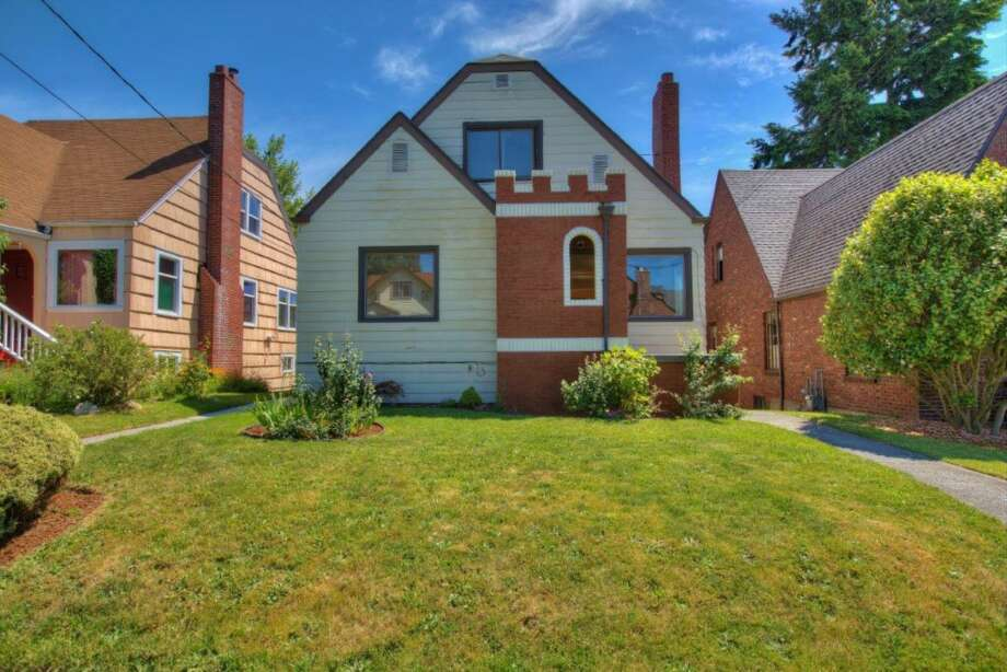 Finally, here's 8006 11th Ave. N.E. The 2,160-square-foot Tudor, built in 1929, has four bedrooms, 2.25 bathrooms, two kitchens, a family room, coved ceilings, inlaid floors and a deck on a 3,400-square-foot lot. It's listed for $468,950, although a sale is pending. Photo: Jim Arcari, Courtesy Laura Ford, Skyline Properties