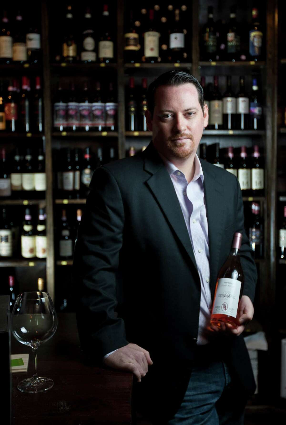 Nathan Smith is the manager and wine director for Dolce Vita Pizzeria and Enoteca, photographed, Wednesday, July 3, 2013, in Houston. ( Nick de la Torre / Houston Chronicle )