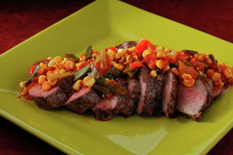 Grilled tri-tip roast with charred tomato-corn relish as seen in San Francisco, California, on June 12, 2013. Food styled by Tara Duggan. Photo: Craig Lee, Special To The Chronicle / ONLINE_YES