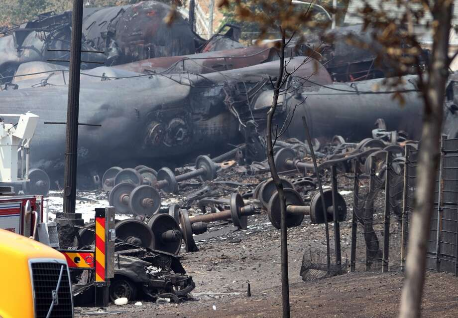 This photo provided by Surete du Quebec, shows debris from a runaway train on Monday, July 8, 2013 in Lac-Megantic, Quebec, Canada.  A runaway train derailed igniting tanker cars carrying crude oil early Saturday, July 6.  At least thirteen people were confirmed dead and nearly 40 others were still missing in a catastrophe that raised questions about the safety of transporting oil by rail instead of pipeline.  (AP Photo/Surete du Quebec, The Canadian Press) Photo: HO, Associated Press
