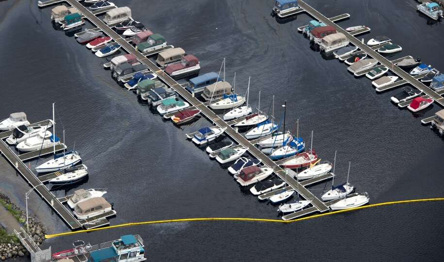 This aerial photo, a oil slick floats on the water at the local marina after Saturday's train derail