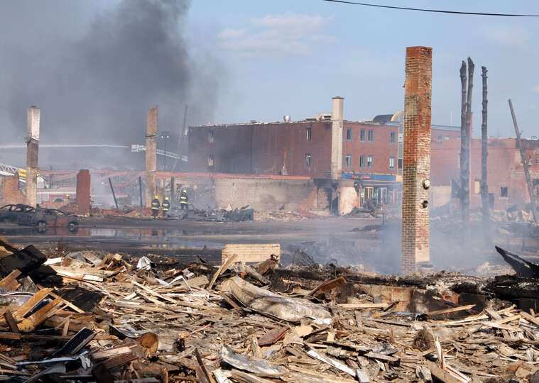 This photo provided by Surete du Quebec, emergency personnel look over the debris from a runaway tra