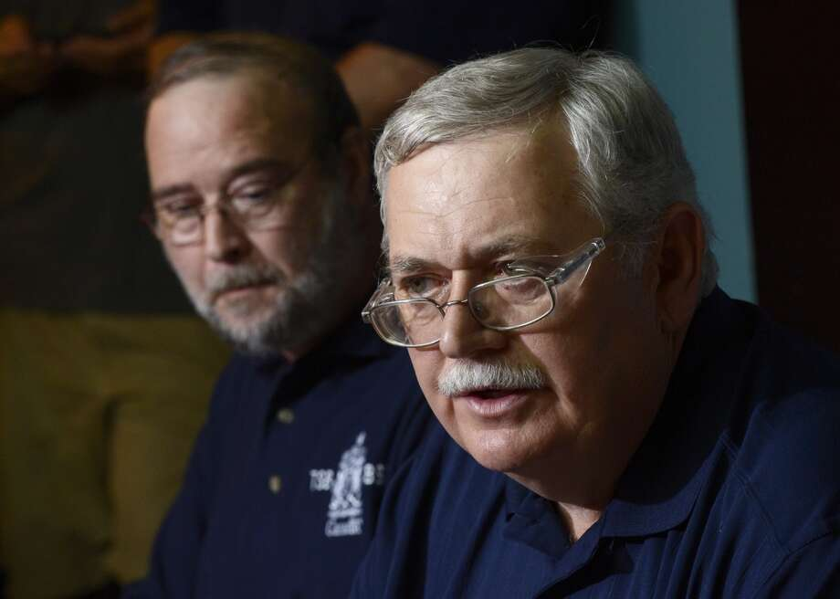 National Transportation Safety Board officials, lead investigator Donald Ross, right,  and regional official Ed Belkaloul (left), address reporters at a news conference in  Lac-Megantic, Quebec, Canada on Tuesday July 9, 2013.  At least thirteen people were confirmed dead and nearly 40 others were still missing in a catastrophe that raised questions about the safety of transporting oil by rail instead of pipeline.  (AP Photo/ The Canadian Press, Ryan Remiorz) Photo: Ryan Remiorz, Associated Press
