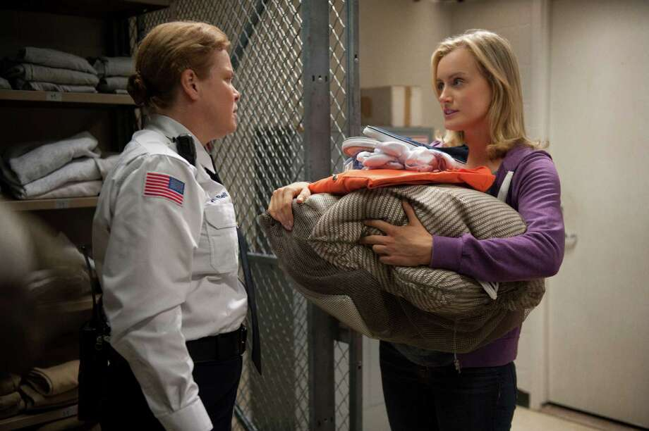 """Piper Chapman (Taylor Schilling, right) meets resistance from a guard (Catherine Curtin) on the first day of her 15-month prison term in Netflix's """"Orange Is the New Black."""" Photo: Barbara Nitke, Handout / ONLINE_YES"""