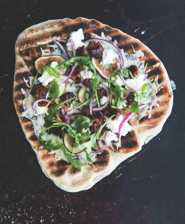 SAUSAGE AND FIG PIZZA with Goat Cheese From  The Grilling Book by Bon Appetit  (Andrews McMeel Publishing) Photo: Andrews McMeel / © Peden and Munk LLC