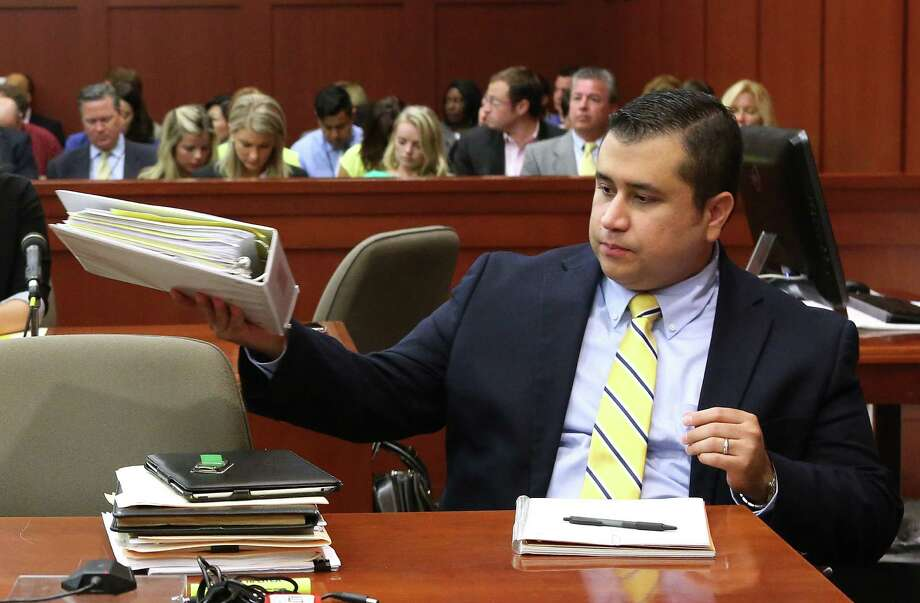George Zimmerman sits at the defense table at his trial in Seminole Circuit Court, in Sanford, Fla., Monday, July  8, 2013. Zimmerman is charged with second-degree murder in the fatal shooting of Trayvon Martin, an unarmed teen, in 2012. Photo: Orlando Sentinel, Joe Burbank, Pool