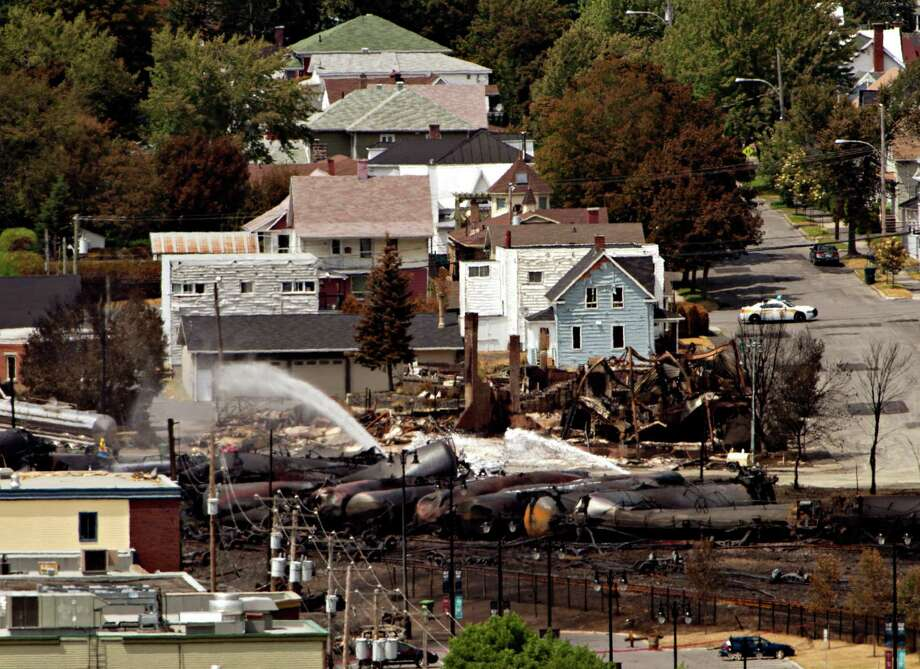 Wreckage is strewn through the downtown core in Lac-Megantic, Quebec, Monday, July 8, 2013, after a train derailed, igniting tanker cars carrying crude oil early Saturday. Photo: The Canadian Press, Ryan Remiorz