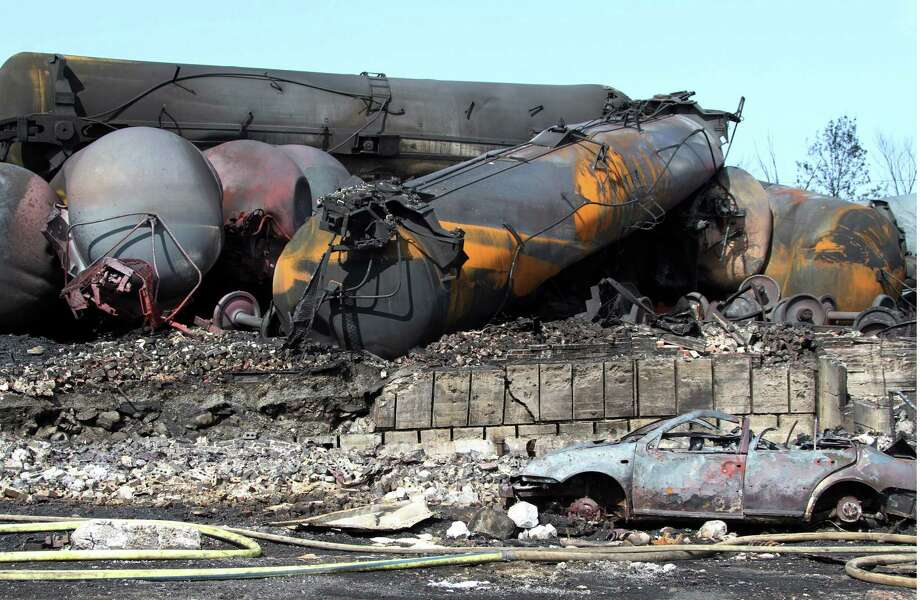This photo provided by Surete du Quebec, shows wrecked oil tankers and debris  from a runaway train on Monday, July 8, 2013 in Lac-Megantic, Quebec, Canada.  A runaway train derailed igniting tanker cars carrying crude oil early Saturday, July 6.  At least thirteen people were confirmed dead and nearly 40 others were still missing in a catastrophe that raised questions about the safety of transporting oil by rail instead of pipeline.  (AP Photo/Surete du Quebec, The Canadian Press) Photo: HO, HOPD / Surete du Quebec via The Canadia