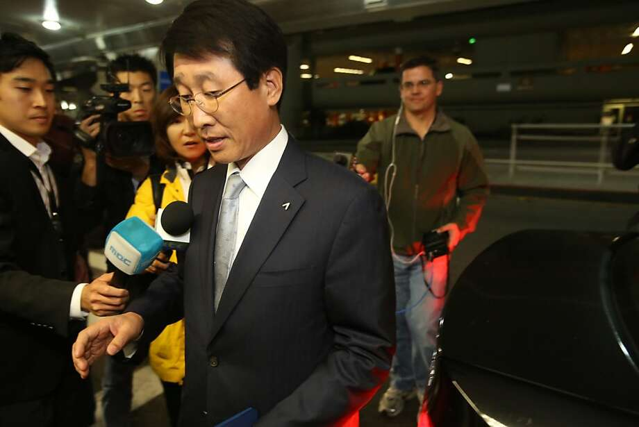 Asiana Airlines official Tae Han is questioned by reporters at San Francisco International Airport on Monday, July 8, 2013. Photo: Mathew Sumner, Special To The Chronicle