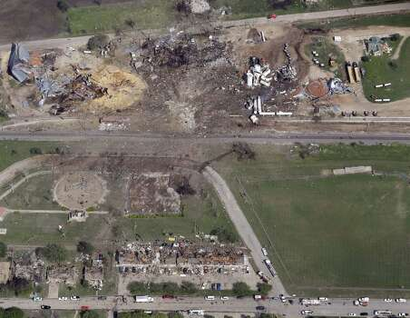 "This April 18, 2013 aerial photo shows a destroyed fertilizer plant, top, following an explosion in West, Texas.  The Federal Emergency Management Agency is refusing to provide money to help rebuild West, the small Texas town where a deadly fertilizer plant explosion leveled numerous homes and a school, and killed 15 people.  According to a letter obtained by The Associated Press, FEMA said it reviewed the state's appeal to help West but decided that the explosion ""is not of the severity and magnitude that warrants a major disaster declaration."" FEMA has, however, provided emergency funds to individual residents. Photo: Associated Press"