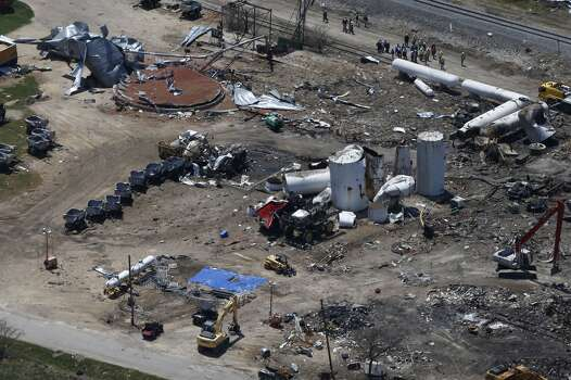 "The damage from the fertilizer plant explosion is seen from helicopters in accompanying President Barack Obama in West, Texas, in this April 25, 2013 file photo. The U.S Chemical Safety Board will tell a Senate committee Thursday June 27, 2013 that regulation of the dangerous chemicals used in the industry fall under a ""patchwork"" of standards that are decades old and are far weaker than rules used by other countries. The findings will be presented to the U.S. Senate Committee on Environment and Public Works. Photo: Associated Press"