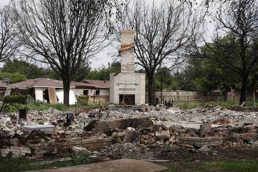 The remains of a home destroyed by the deadly fertilizer plant explosion Friday, June 14, 2013, in West. ( James Nielsen / Houston Chronicle ) Photo: Houston Chronicle