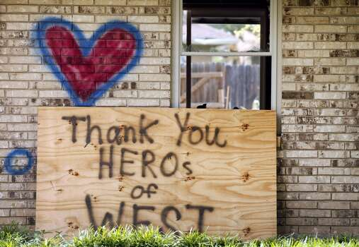 A home spray painted with a heart and an inspirational message, damaged by the fertilizer plant explosion along Reagan Street is shown Friday, May 31, 2013, in West, Texas. Town officials and many lifelong residents desperately want to keep people from moving away, but they face a long fight ahead of them. (AP Photo/Tony Gutierrez) Photo: Associated Press
