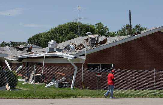 A man walks past the West Rest Haven nursing home which was damaged from the deadly fertilizer plant explosion, Thursday, June 13, 2013, in West. Photo: Houston Chronicle