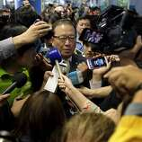 A crush of reporters and photographers converge on Yoon Young-doo (center), CEO of Asiana Airlines, as he makes a brief comment after arriving at SFO before retreating to a secure area of the International Terminal.