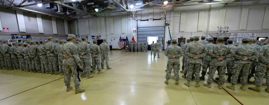 The New York Army National Guard's 206th Military Police Company, a unit which has served in Iraq and responded to Hurricane Sandy in 2012, got a new leader Tuesday, July 9, 2013. Capt. Carlos Nazario, a veteran of the wars in Afghanistan and Iraq, took command of the unit from Capt. Kevin Jusza during a ceremony held at the Division of Military and Naval Affairs in Latham, N.Y. (Skip Dickstein/Times Union) Photo: Skip Dickstein / 10023100A