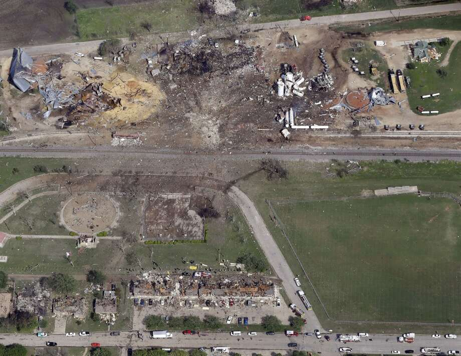"""This April 18, 2013 aerial photo shows a destroyed fertilizer plant, top, following an explosion in West, Texas.  The Federal Emergency Management Agency is refusing to provide money to help rebuild West, the small Texas town where a deadly fertilizer plant explosion leveled numerous homes and a school, and killed 15 people.  According to a letter obtained by The Associated Press, FEMA said it reviewed the state's appeal to help West but decided that the explosion """"is not of the severity and magnitude that warrants a major disaster declaration."""" FEMA has, however, provided emergency funds to individual residents.  (AP Photo/Tony Gutierrez) Photo: Associated Press"""