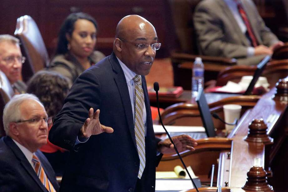 Illinois Sen. Kwame Raoul, D-Chicago, argues concealed carry gun legislation while on the Senate floor during session at the Illinois State Capitol Tuesday, July 9, 2013, in Springfield, Ill. Illinois became the last state in the nation to allow public possession of concealed guns as lawmakers rushed Tuesday to finalize a proposal ahead of a federal court's deadline. (AP Photo/Seth Perlman) Photo: Seth Perlman, STF / AP
