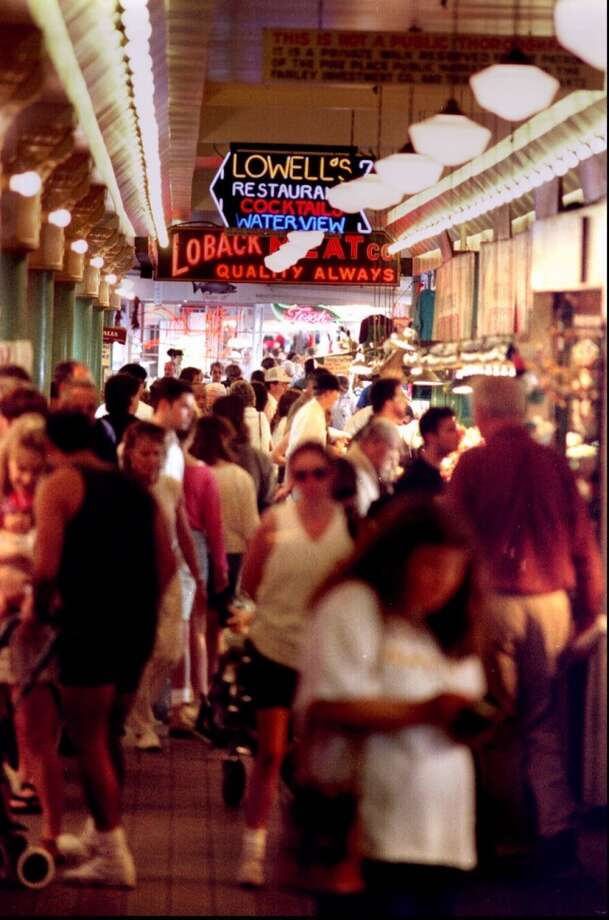 They make it nearly impossible to do any real grocery shopping at Pike Place Market in the summer. Photo: TOM MARKS