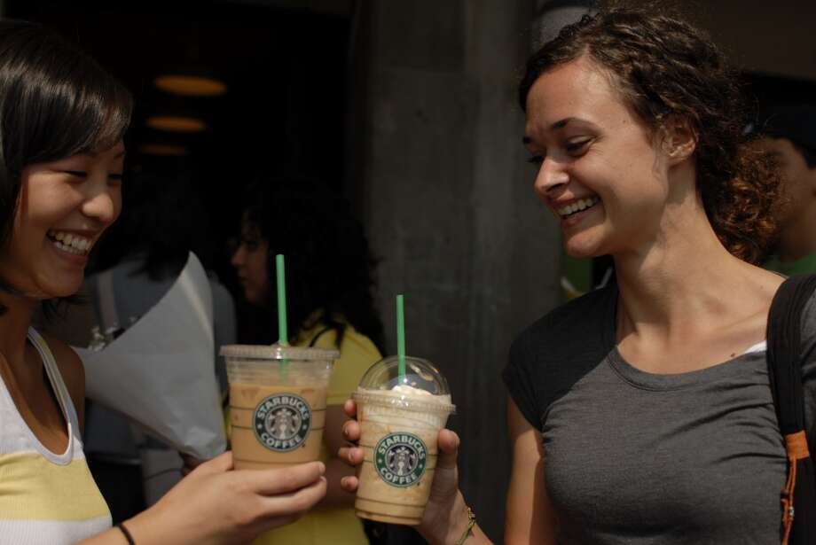 So maybe we're the goofy ones, silently thinking they're goofy for toasting one another with Frappuccinos, when they're just having a great time in a terrific city. Photo: Melanie Conner, Getty Images