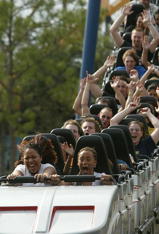 Shunice Colston and family friend Ayanna Sweetnam, 10, ride the 'Greezed Lighting' roller coaster on AstroWorld's last day open to the public. Photo: Mayra Beltran, Houston Chronicle / Houston Chronicle
