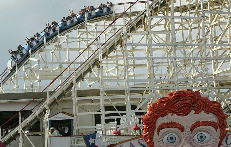 Roller-coaster enthusiasts ride the Texas Cyclone on Sunday as AstroWorld ended 37 years of providing thrills to generations of Houstonians. Photo: Mayra Beltran, Houston Chronicle / Houston Chronicle