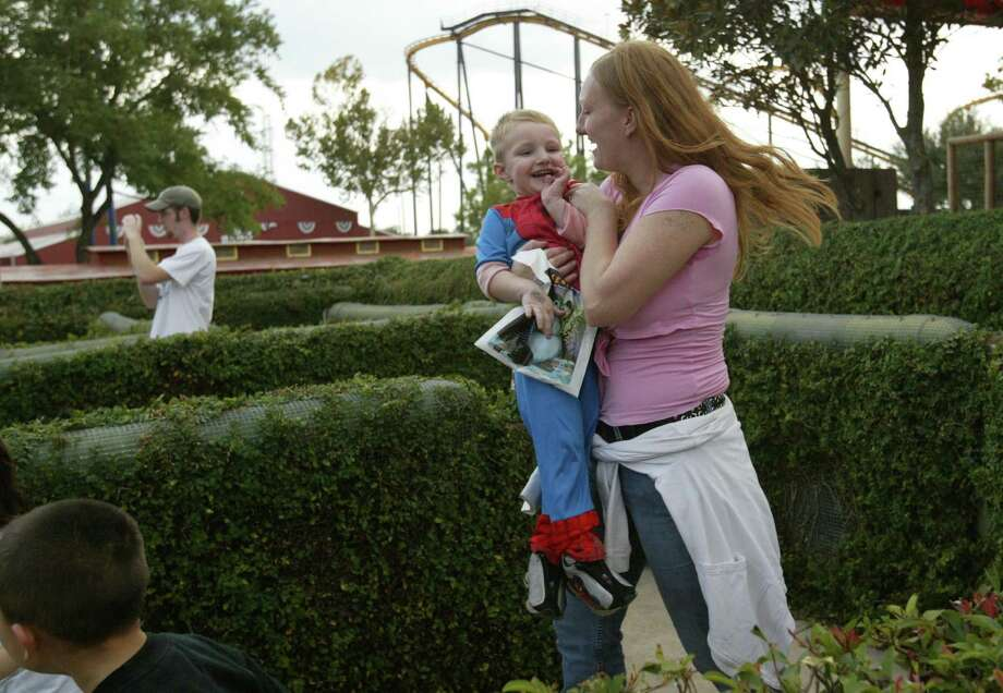 Tiffany Simmons grabs her son Kyle Simmons, 3, in the maze on AstroWorld's last day open to the public.  She had gone to AstroWorld since she was a child, and was disappointed her son would not be able to enjoy the adult rides. Photo: Mayra Beltran, Houston Chronicle / Houston Chronicle