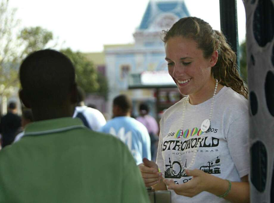 Melynda Massey, 17, receives tickets in the entrance of AstroWorld on the last day open to the public.  She is wearing a limited edition AstroWorld 1968-2005 T-Shirt available only to employees. Photo: Mayra Beltran, Houston Chronicle / Houston Chronicle