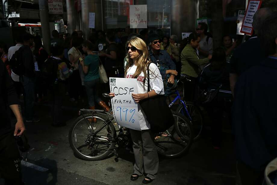 CCSF Physics Professor Jill Johnsen holds a sign during a protest against  the possibility of the revocation of the City College of San Francisco in San Francisco, Calif. on July 9, 2013. Photo: Ian C. Bates, The Chronicle