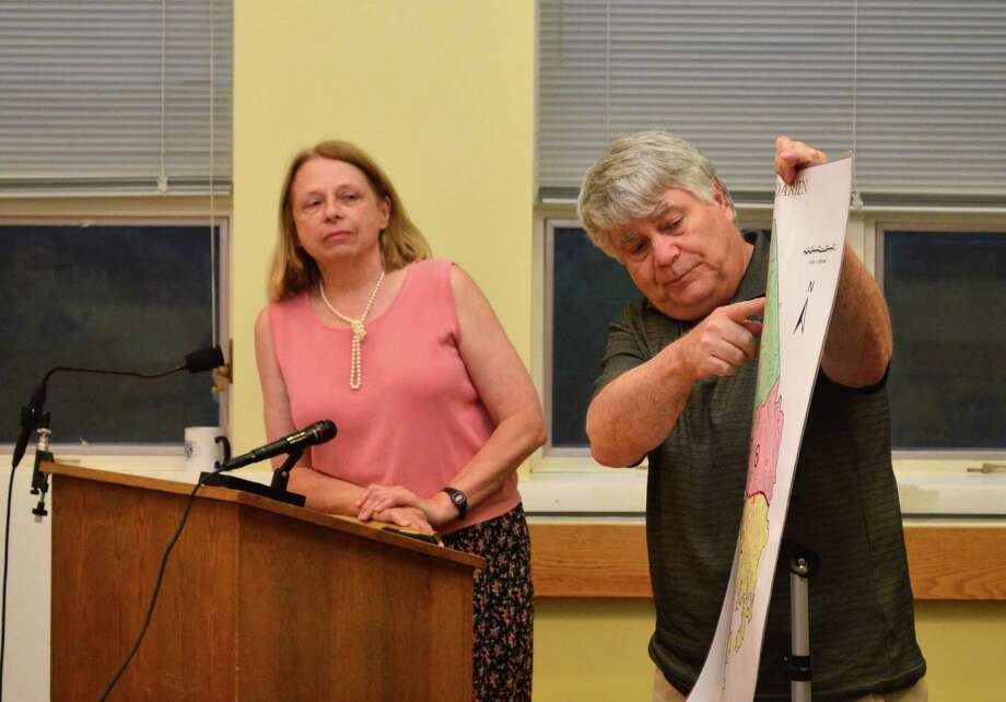 Kathy Hammell, Democratic registrar of voters, and John Visi, Republican registrar of voters, presented their proposed changes to three of the polling places in Darien. Photo: Megan Spicer