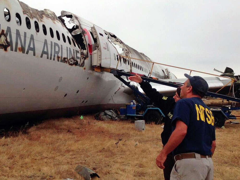 National Transportation Safety Board investigator Bill English and NTSB Chairwoman Deborah Hersman examine the remains of Asiana Airlines Flight 214. Photo: HOPD / National Transportation Safety B