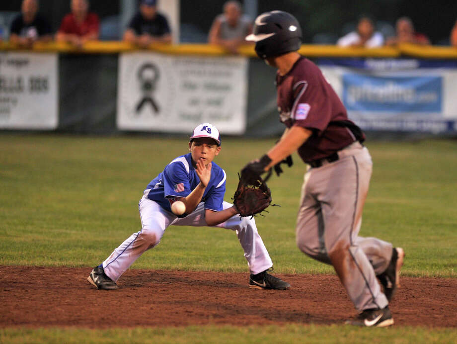 North Stamford shortstop Noah Skaug fields the ball during their District 1 Little League semifinal game against Stamford National at Scalzi Park in Stamford on Tuesday, July 9, 2013. Photo: Jason Rearick / Stamford Advocate
