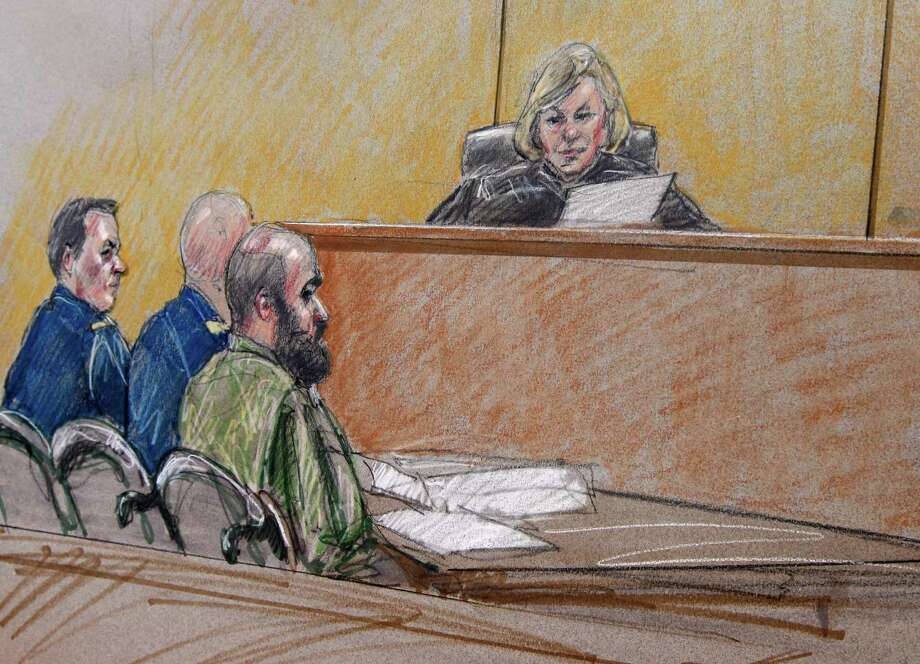 In this courtroom sketch, U.S. Army Maj. Nidal Hasan, right, sits by his former defense attorneys Maj. Joseph Marcee, far left, and Lt. Col. Kris Poppe, center, with Judge, Col. Tara Osborn, behind the bench during a pretrial hearing, Tuesday, July 9, 2013, in Fort Hood, Texas. Jury selection is set to start Tuesday in the long-awaited murder trial of Hasan, the Army psychiatrist accused of opening fire with a semi-automatic gun at Fort Hood nearly four years ago. (AP Photo/Tony Gutierrez) Photo: Brigitte Woosley, FRE / FR170958 AP