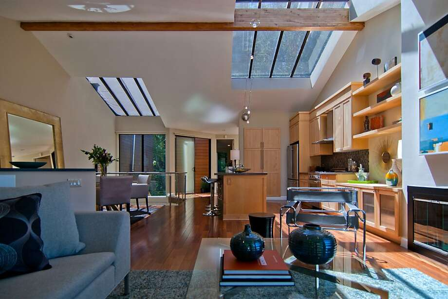 The great room also features a glass rail that borders the den/office below. Photo: Luxe Home Tours
