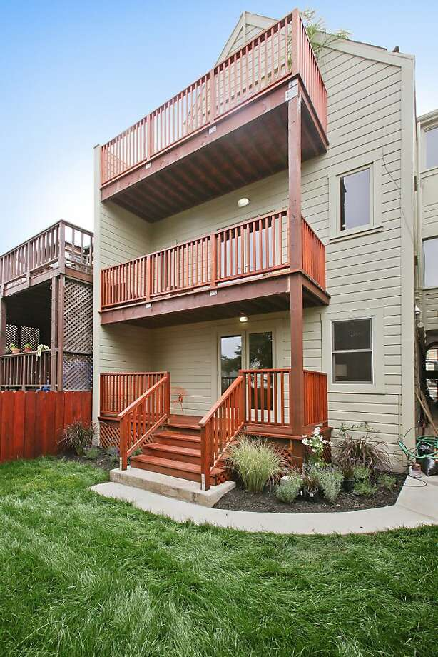 The home includes decks on all three levels. Photo: OpenHomesPhotography.com